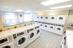 Image of the laundry facilities at RCC - Barrie. There\'s a number of washing machines and dryers