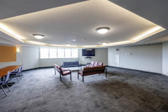 Image of the Meeting space at RCC - Barrie. It\'s a large space with seating set-up.