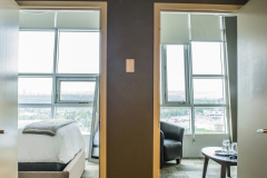 Image of one of the corporate suites at RCC - Calgary looking at the entrance to bedroom and den.