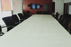 Image of the Meeting space at RCC - Calgary. It's a large space with seating set-up.