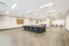 Image of the conference space at RCC - Hamilton. It\'s a large space with seating set-up.