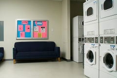 Image of the laundry facilities at RCC-Kamloops. There's a number of washing machines and dryers