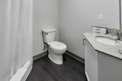 Image of the washroom at RCC-King City. Includes a stand-up shower, vanity and toilet