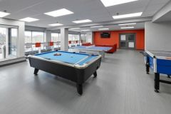 Image of the Games Lounge at RCC-King City. There is a pool table, ping pong table and a foosball table.