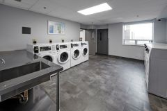 Image of the laundry facilities at RCC-King City. There's a number of washing machines and dryers