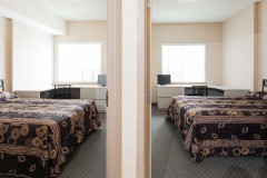 Image of one of the suites at RCC-Kitchener-Waterloo. Looking at the entrance to both bedrooms.