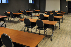 Image of the Meeting space at RCC-Kitchener-Waterloo. It's a large space with seating set-up.