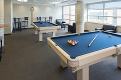 Image of the games lounge at RCC-Oshawa. Includes 2 pool tables.