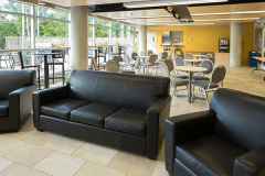 Image of the lounge space at RCC-Oshawa. It's a large space with seating set-up.