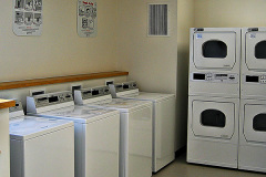 Image of the laundry facilities at RCC-Ottawa Downtown. There's a number of washing machines and dryers.