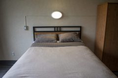 Image of one of the bedrooms in the suites at RCC-Sarnia. Includes a double xl bed.
