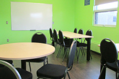 Image of the meeting space at RCC-Thunder Bay. It's a large space with seating set up.