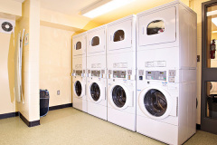 Image of the laundry facilities at RCC-Sudbury West. There's a number of washing machines and dryers