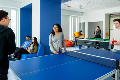 Image of the games lounge at RCC-Toronto Downtown. Includes a ping pong table and a pool table.