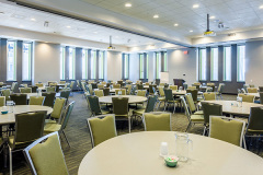 Image of the conference space at RCC-Toronto Downtown. It's a large space with seating set-up.