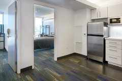 Image of one of the suites at RCC-Toronto Downtown looking at the entrance to both bedrooms.