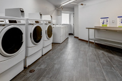 Image of the laundry facilities at RCC - Toronto. There's a number of washing machines and dryers