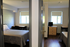 Image of one of the suites at RCC-Welland looking at the entrance to both bedrooms.
