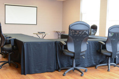 Image of the Meeting space at RCC-Welland. It's a large space with seating set-up.