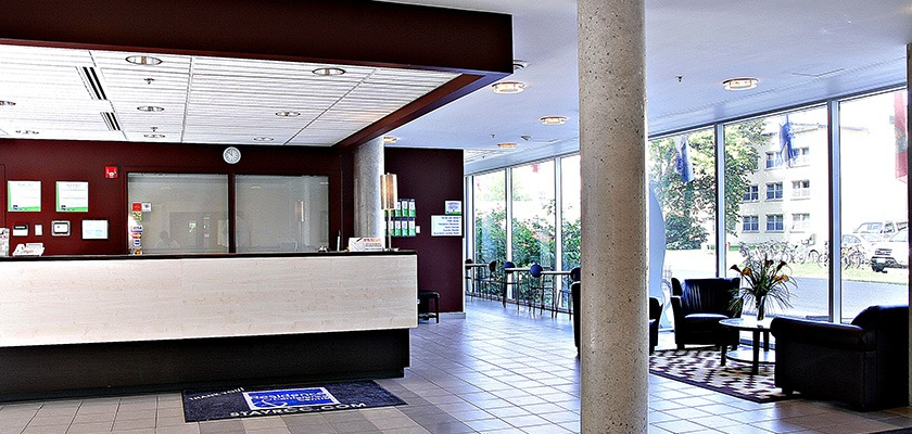 Lobby of RCC - Ottawa West. The front desk, and seating is displayed.