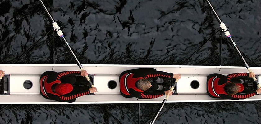 Overhead image of a rowing crew on the water.