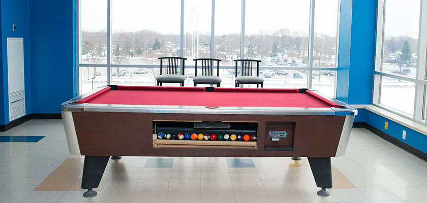 Games room at RCC - Windsor. There's a pool table, and large windows.