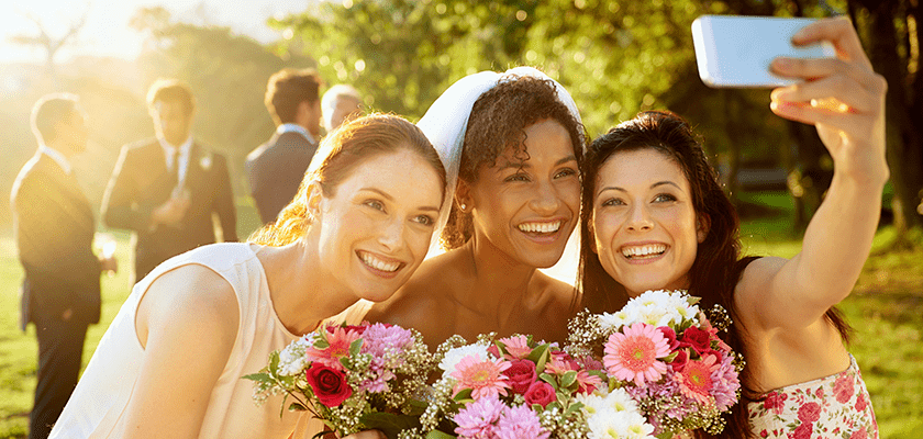Image of a bride and her friends taking a selfie.