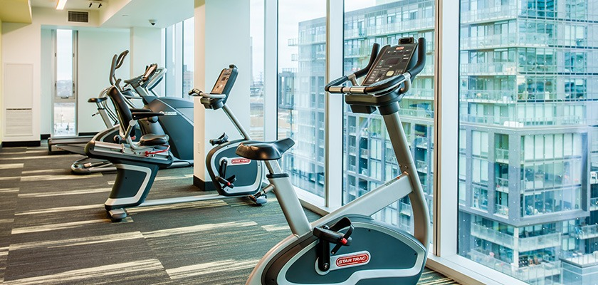 Fitness room at RCC - Toronto Downtown. There's exercise bikes facing out a window.