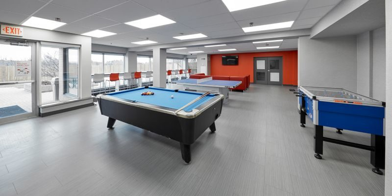 Games Lounge at RCC - King City - there's a pool table, table tennis, foosball and in the background a couch and a TV.