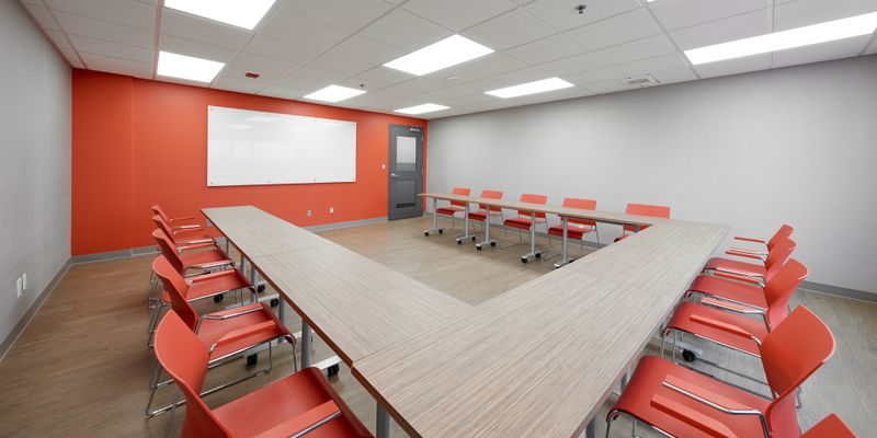 Meeting space at RCC - King City; there's u-shaped seating facing a whiteboard.