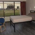 Image of RCC accommodation, showing half of the beds in the room.