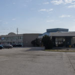 Image of main entrance of RCC - Sarnia. Shows signage and adjacent parking.