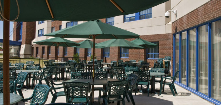 Photo of patio at RCC - Georgian. There are tables, chairs and umbrellas.