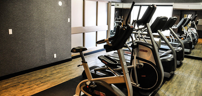 Image of cardio equipment - there is an exercise bike, elliptical and two treadmills.